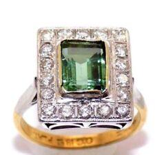 Anelli con diamanti tondi smeraldo di colore fantasia