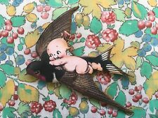 Handmade vintage style, wooden laser cut  brooch - kitsch Kewpie with swallow
