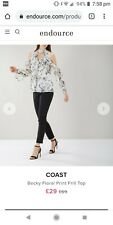 Beautiful Coast blouse size 12, white, with flowers, halter style with sleeves