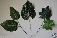 Fiori e piante finte in plastica verde per la decorazione della casa