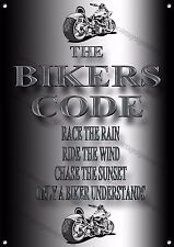 THE BIKERS CODE RACE THE RAIN,RIDE THE WIND,CHASE THE SUNSET METAL SIGN.