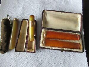 Lot de 4  anciens Fume Cigarette Cigare ambre et or poinçon tête d'aigle