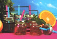 Set di 6 piccoli barattoli di vetro con cannucce in metallo portante. Set di 6 bicchieri da punch