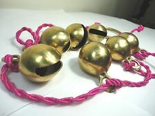 Seven Brass Bells on pink rope  Clams Shaped Door Shop /store. Colectibles