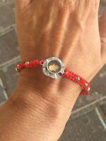 Red string spinning lucky hand Hamsa Kabbalah protection bracelet from Jerusalem