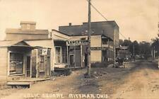 Rittman OH Public Square Dirt street Storefronts Horse & Wagons RPPC Postcard