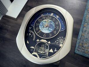 Small World Rhythm DWS Peaceful Cosmos musical Wall Clock