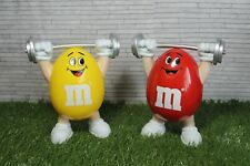 More details for vintage 1991 weightlifting m&m candy dispensers red and yellow