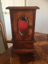 Minature wooden cabinet with mirror