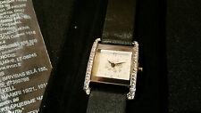 Avon Ladies Watch in a pouch.