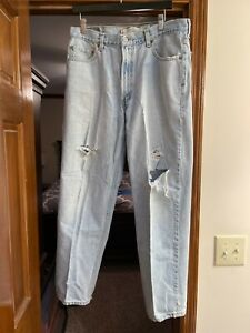 Levis 550 Jeans 36x32 Relaxed Fit Naturally Distressed with rips 100% cotton