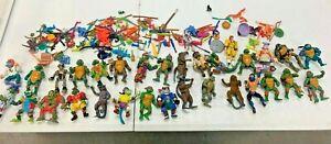 Lot of 30 Teenage Mutant Ninja Turtles w/ Accessories Playmates Vintage