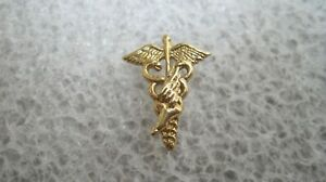 14k Gold medical symbol podiatry foot with wings Tie Tac Lapel Pin