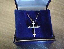 9ct gold small diamond 0.10ct cross and delicate chain. Comes in box