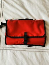 Skip Hop red travel diaper clutch tote