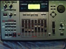 Reduced 12/09  BOSS BR-8 recording studio powers on + power chord