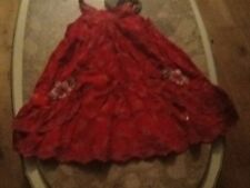 Catimini red dress with lace studs and flowers.