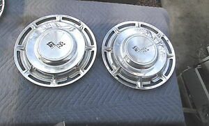 """Vintage Set of 2 1960 Chevy Car Double Flag Hubcaps 14"""" Very Good Condition"""