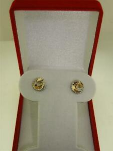 BEAUTIFUL 10K GOLD SWIRL WITH APPROX. 1/8 CTW SPARKLING DIAMOND STUD EARRINGS!