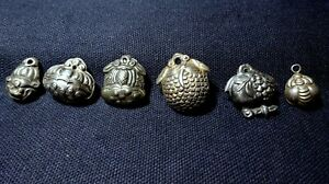 A Collection of 6 Chinese Silver Ethnic Minority Charm Rattle Pendants