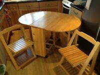 Oval wooden folding dining table and 4 folding chairs (stored within table)