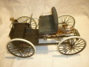 A Franklin mint scale model of a 1896 Ford Quadricycle, Ford's first car,