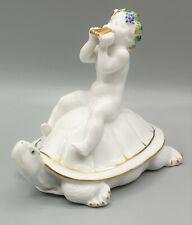 Porzellanfigur Rosenthal, auf Schildkröte sitzender Putto, Panflöte spielend
