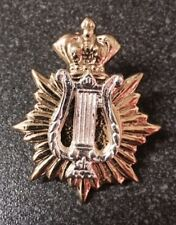 GOLD STAR & CROWN CAP BADGE WITH SILVER MUSIC LYRE