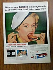 1958 Gleem Toothpaste Ad  Lady eating small Burger