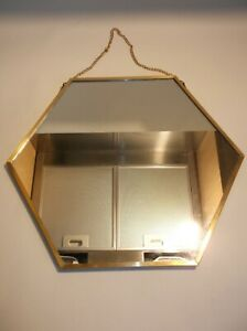 HEXAGONAL WALL MIRROR IN UNUSED CONDITION- BEAUTIFUL WITH GOLD COLOURED RIM.