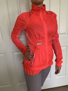 Lululemon  Size 4 Run Nothin' But Jacket Rain Water Resistant Neon Orange Pink