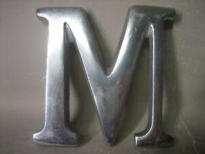 """""""M"""" metal letter sign"""