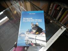 Nomade du Grand Nord . En kayak de mer avec un chien esquimau, Kim Hafez
