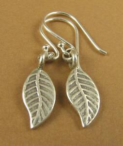 Curvy leaf shaped silver earrings. Small. Fine & sterling silver hooks 925.