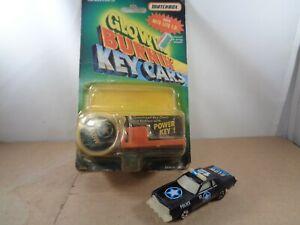 Matchbox Kidco Glowin Burnin` Key Cars GLOW PATROL In Black.W/Packaging.Vintage