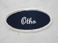 OTHO USED EMBROIDERED  SEW ON NAME PATCH TAG OVAL WHITE ON DARK BLUE