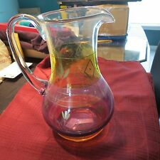 handmade pitcher from romania with pink purple yellow & orange colors throught -