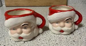 TWO  VINTAGE CHRISTMAS SANTA CLAUS MUGS CERAMIC HAND MADE