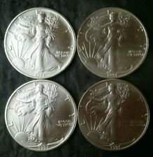 Lot of Four 1991 $1 American Silver Eagle Dollars