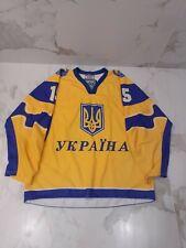 IIHF TACKLA UKRAINE GAME WORN USED GOLD JERSEY #15 NOBR
