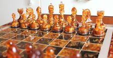 A unique set of handmade chess inlaid with Baltic amber