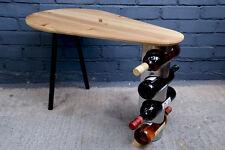 Sleek, teardrop shaped wooden table. Pine top with 3 legs & built in wine rack!