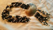 Black and white seed bead multistrand necklace with mother of pearl disc tribal