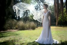 Long, flower patterned lace, white, short train wedding dress with a lining.