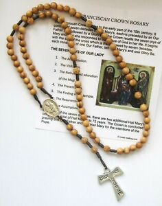 Franciscan Crown 7 decade Olive Wood Rosary and prayer card.