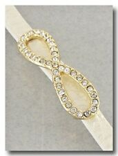 Beautiful Gold and Crystal Sparkle Infinity Bracelet on White Shimmer Leather Ba