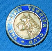 An antique or vintage Cairn Terrier Club badge with raised dog face and enamel