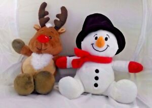 Christmas themed soft cuddly toys one is a reindeer and one snowman soft toys