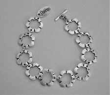 H952:) Signed Treaty flower panel linked silver tone toggle clasp bracelet