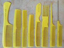 8 pieces yellow TRIUMPH MASTER german hair combs by Hercules Sägemann